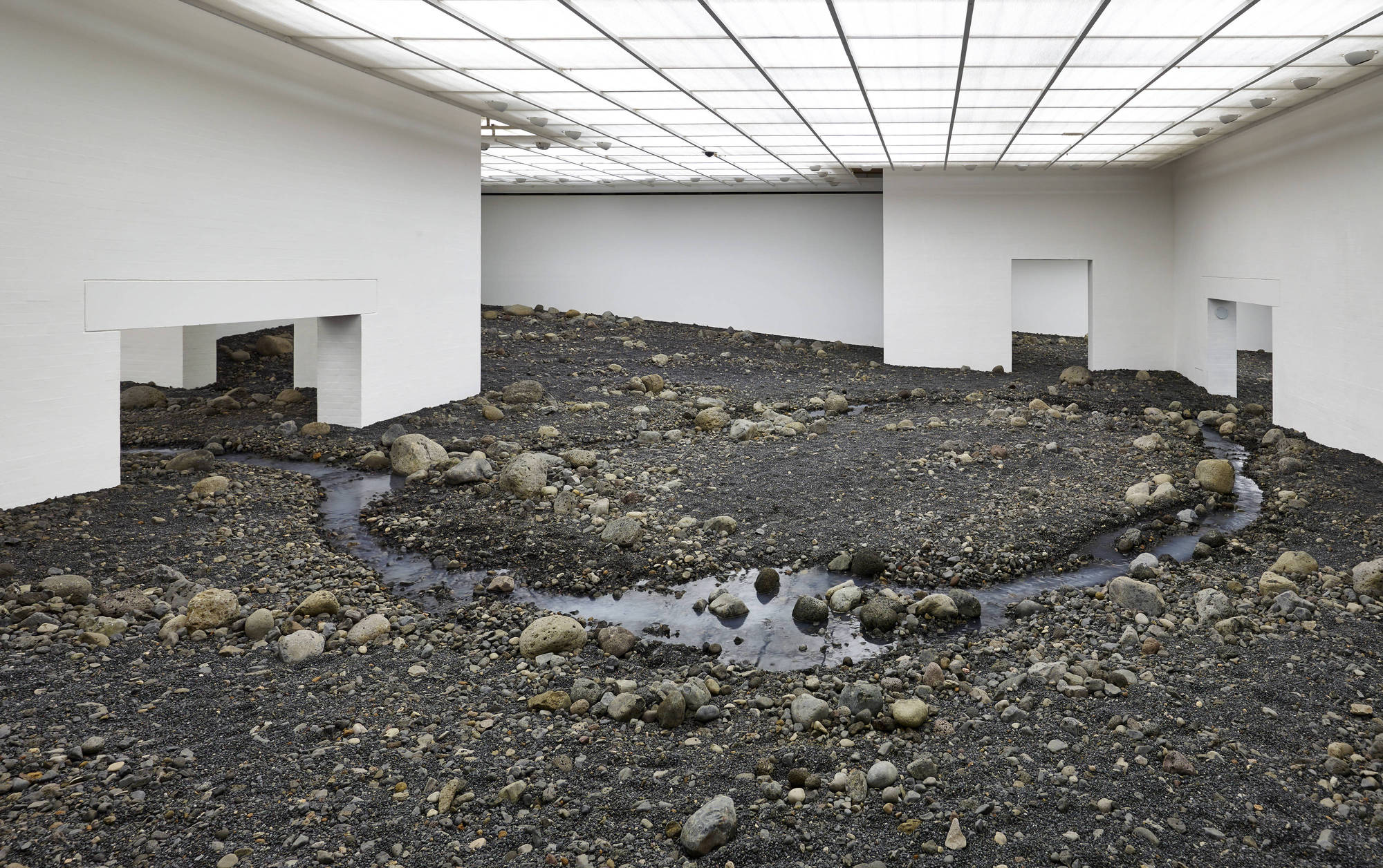 53f743acc07a80388e000717_olafur-eliasson-creates-an-indoor-riverbed-at-danish-museum_cf017216